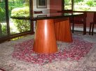Brazilian cherry and stone dining table
